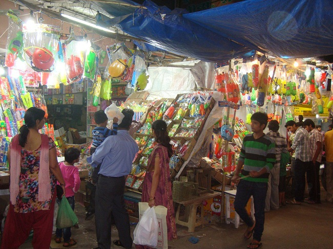 Parents are buying holi items for their children