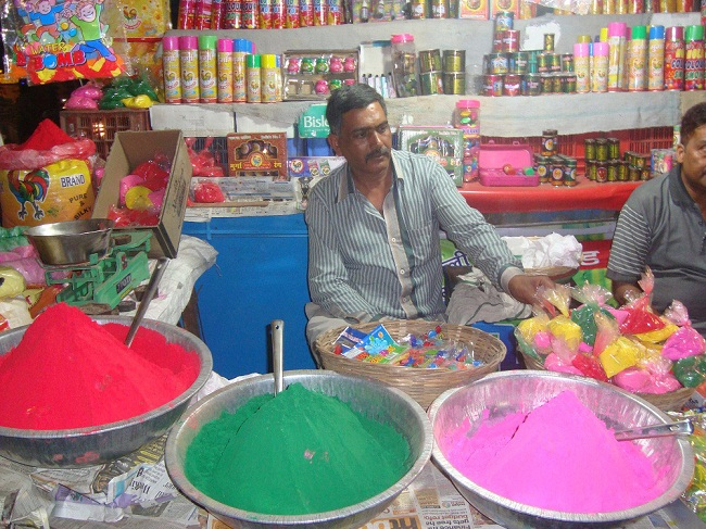 A shopkeeper selling holi colors